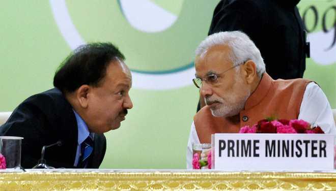 Modi and Harshvardhan